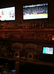 wall of whisky, ruined by flat screens.